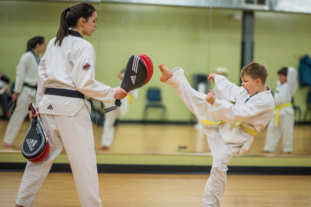Bloomington Fitness - Excel Tae Kwon Do boy kicking