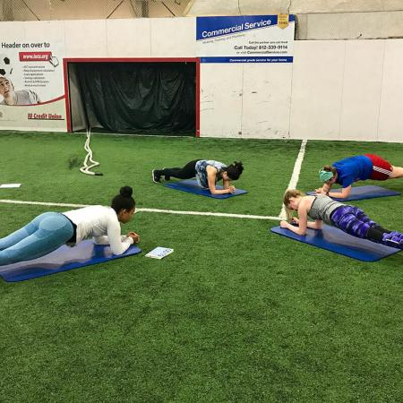 Bloomington Group Exercise - Turf Field Planking