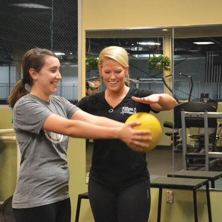 Megan personal training with ball
